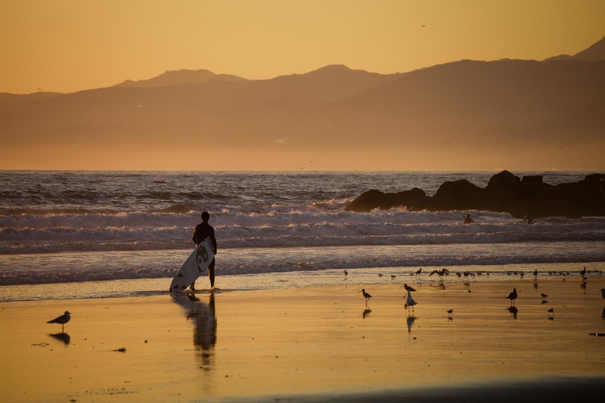 """""""Surfista"""" em f/8 1/250 ISO125 @ 300mm; vinheta ainda em f/8."""