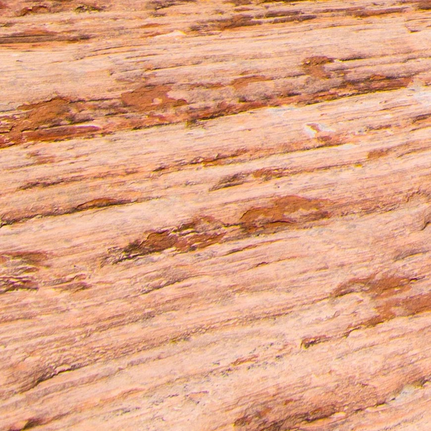 Crop 100%, texturas de pedras, vincos e tons com boa nitidez.