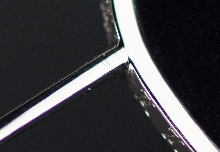 Crop 100%, detalhes mínimos de aberrações cromáticas fora do plano focal.